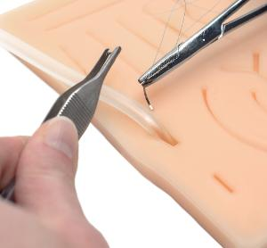 Suture practice pad with tube